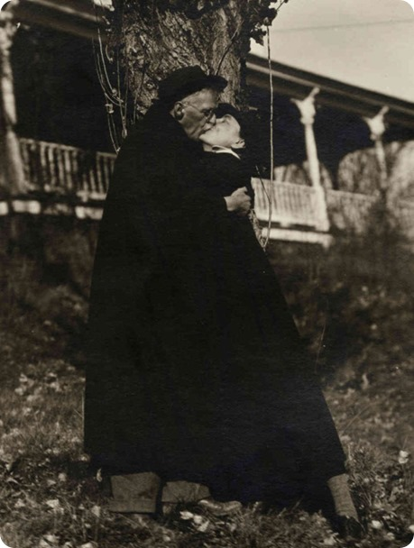 Georgia O'Keeffe and Alfred Stieglitz kissing at Lake George, 1929